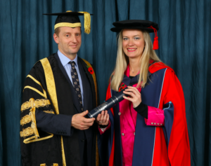 Lord Burlington presents Lizzie with her Honorary Degree from the University of Derby